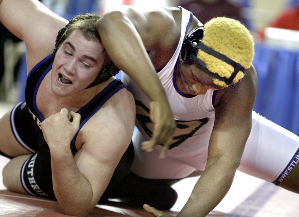 Photo - Guthrie's Landry Chappell wrestles Chickasha's Jocoby Brown during the state wrestling championships at the State Fair Arena in Oklahoma City, Saturday, Feb. 25, 2012. Photo by Sarah Phipps, The Oklahoman