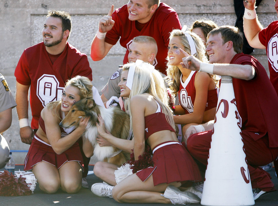 Photo - OU cheerleaders pose for a photograph with Reveille VII during the college football game between the University of Oklahoma and Texas A&M University at Kyle Field in College Station, Texas, Saturday, November 8, 2008.  BY BRYAN TERRY, THE OKLAHOMAN