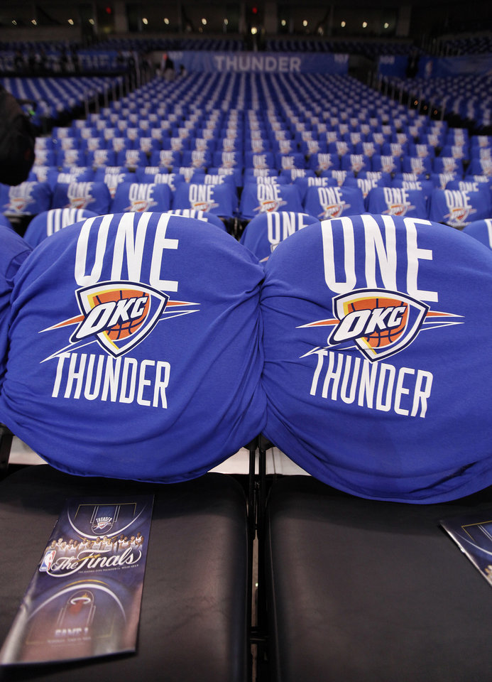 Thunder shirts line the seats for Game 1 of the NBA Finals between the Oklahoma City Thunder and the Miami Heat at Chesapeake Energy Arena in Oklahoma City, Tuesday, June 12, 2012. Photo by Chris Landsberger, The Oklahoman