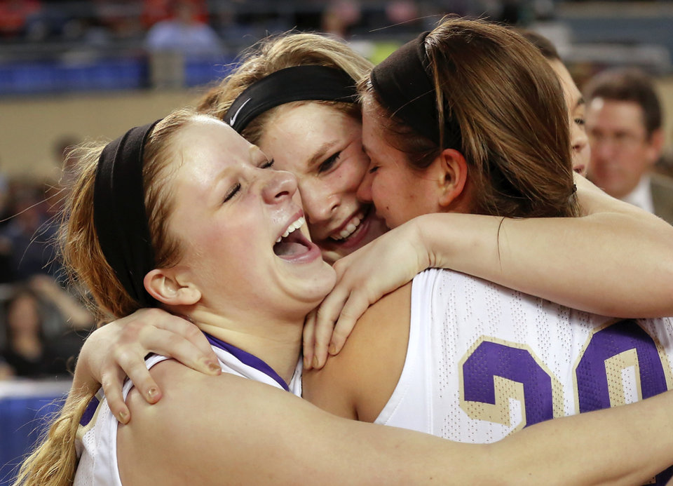 Photo - From left, Okarche players Madi Grellner, Kenadey Grellner and Morgan Vogt celebrate after winning the Class B girls high school basketball championship game in the Jim Norick Arena at State Fair Park on  Saturday, March 8, 2014. Okarche defeated Red Oak,  66-41. Photo by Jim Beckel, The Oklahoman