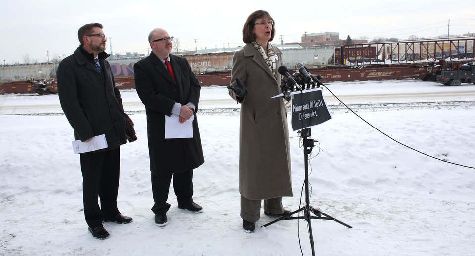 Photo - Kathy Hollander addresses the media about her concerns about the state's ability to react to an oil spill or explosion during a press conference near a rail way in St. Paul, Minn., Wednesday, Feb. 12, 2014. Recent crude oil train catastrophes in North Dakota and Canada show that Minnesota needs to beef up its ability to protect its communities from similar disasters. Looking on are state Rep. Frank Hornstien, center, and state Sen. Scott Dibble, left, who outlined a bill they plan to introduce at the start of the upcoming legislative session. (AP Photo/The Star Tribune, Kyndell Harkness) MANDATORY CREDIT; ST. PAUL PIONEER PRESS OUT; MAGS OUT; TWIN CITIES TV OUT