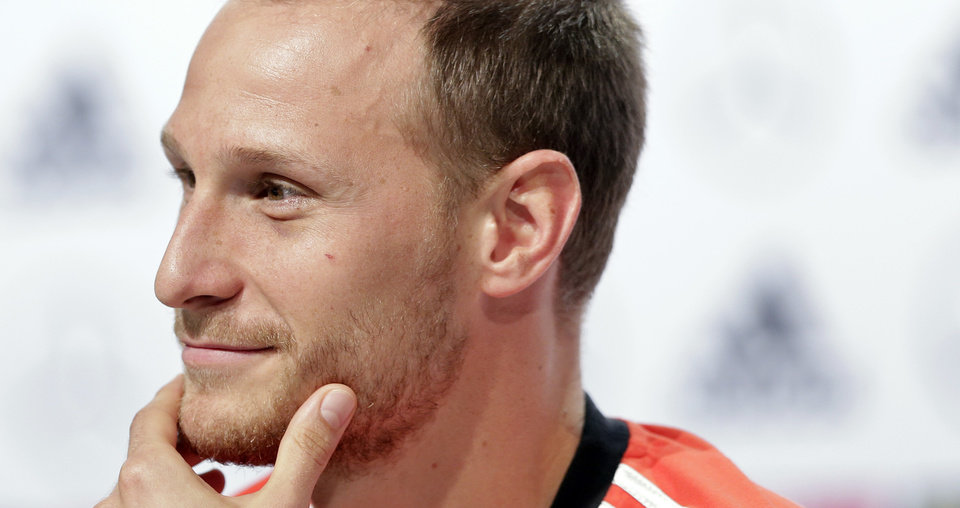 Photo - German national soccer player Benedikt Hoewedes attends a news conference in Santo Andre near Porto Seguro, Brazil, Thursday, July 10, 2014. Germany faces Argentina on upcoming Sunday in Maracana Stadium in Rio de Janeiro, in the final of the World Cup. (AP Photo/Matthias Schrader)