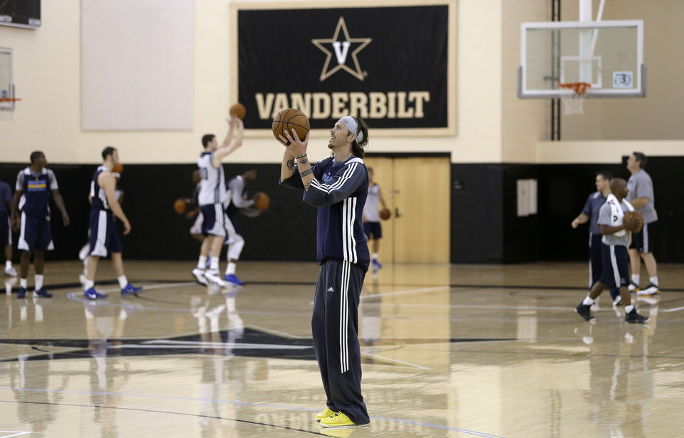 Photo - Memphis Grizzlies' Mike Miller, center, shoots during NBA basketball training camp at Vanderbilt University on Tuesday, Oct. 1, 2013, in Nashville, Tenn. The Grizzlies are scheduled to hold training camp in Nashville through Saturday. (AP Photo/Mark Humphrey)