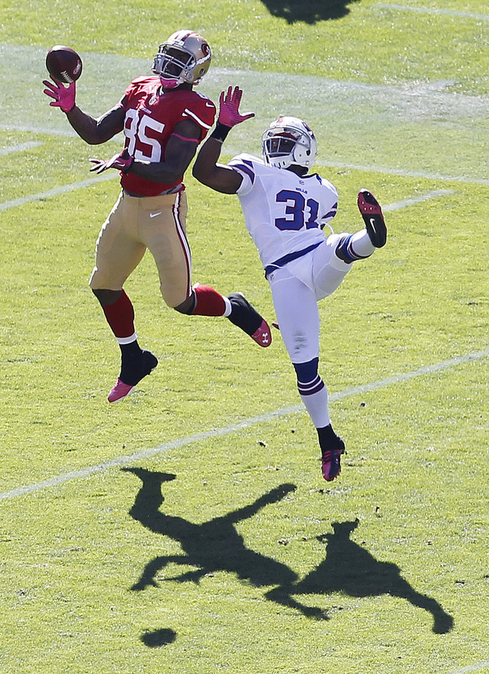 San Francisco 49ers tight end Vernon Davis (85) cannot make a catch over Buffalo Bills free safety Jairus Byrd (31) during the third quarter of an NFL football game in San Francisco, Sunday, Oct. 7, 2012. (AP Photo/Tony Avelar)