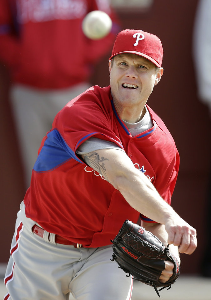 Photo - Philadelphia Phillies relief pitcher Jonathan Papelbon throws a pitch during spring training baseball practice Thursday, Feb. 13, 2014, in Clearwater, Fla. (AP Photo/Charlie Neibergall)