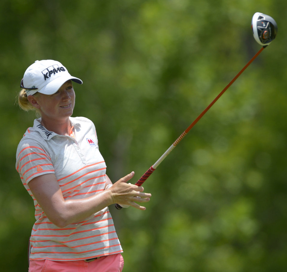 Photo - Stacy Lewis watches the flight of her tee shot on the fourth hole in the final round of the Airbus LPGA Classic golf tournament at Magnolia Grove on Sunday, May 25, 2014, in Mobile, Ala. (AP Photo/G.M. Andrews)