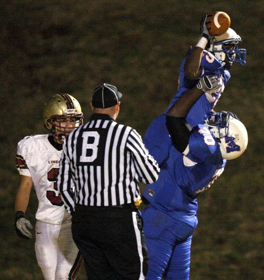 Millwood's Sheldon Bulock celebrates with Devin Dobbins, bottom right, beside Lincoln Christian's Joel Klotz during a Class 2A high school football playoff game between Millwood and Lincoln Christian in Oklahoma City, Friday, Nov. 25, 2011. Photo by Bryan Terry, The Oklahoman