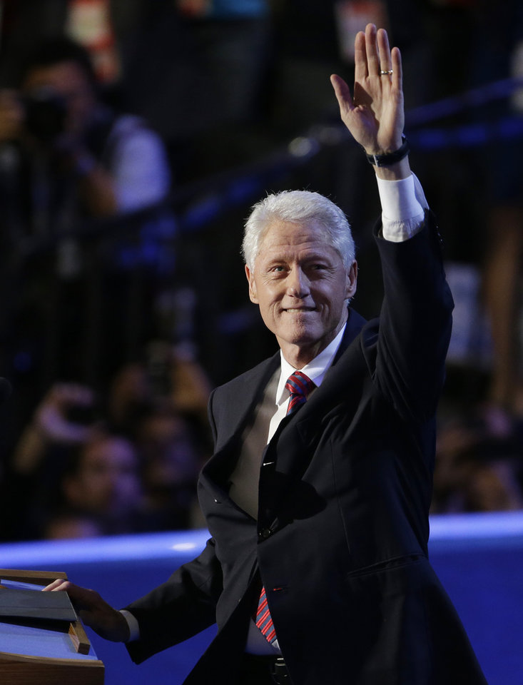 Photo - Former President Bill Clinton waves to delegates at the Democratic National Convention in Charlotte, N.C., on Wednesday, Sept. 5, 2012. (AP Photo/Lynne Sladky)  ORG XMIT: DNC186