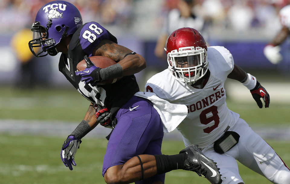 Oklahoma\'s Gabe Lynn (9) chases down TCU\'s Cam White (88) during a college football game between the University of Oklahoma Sooners (OU) and the Texas Christian University Horned Frogs (TCU) at Amon G. Carter Stadium in Fort Worth, Texas, Saturday, Dec. 1, 2012. Oklahoma won 24-17. Photo by Bryan Terry, The Oklahoman