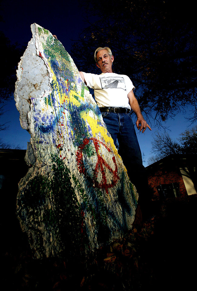 Photo - Randy Powers poses with a piece of graffiti bridge outside his home in Oklahoma City on Nov. 17, 2008. By John Clanton, The Oklahoman