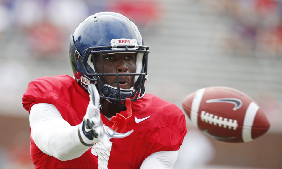 Photo - Mississippi wide receiver Laquon Treadwell (1) reaches for a pass during the team's final open NCAA college football practice, Saturday, Aug. 9, 2014, at Mississippi, in Oxford, Miss. Players were involved in individual and team drills. (AP Photo/Rogelio V. Solis)