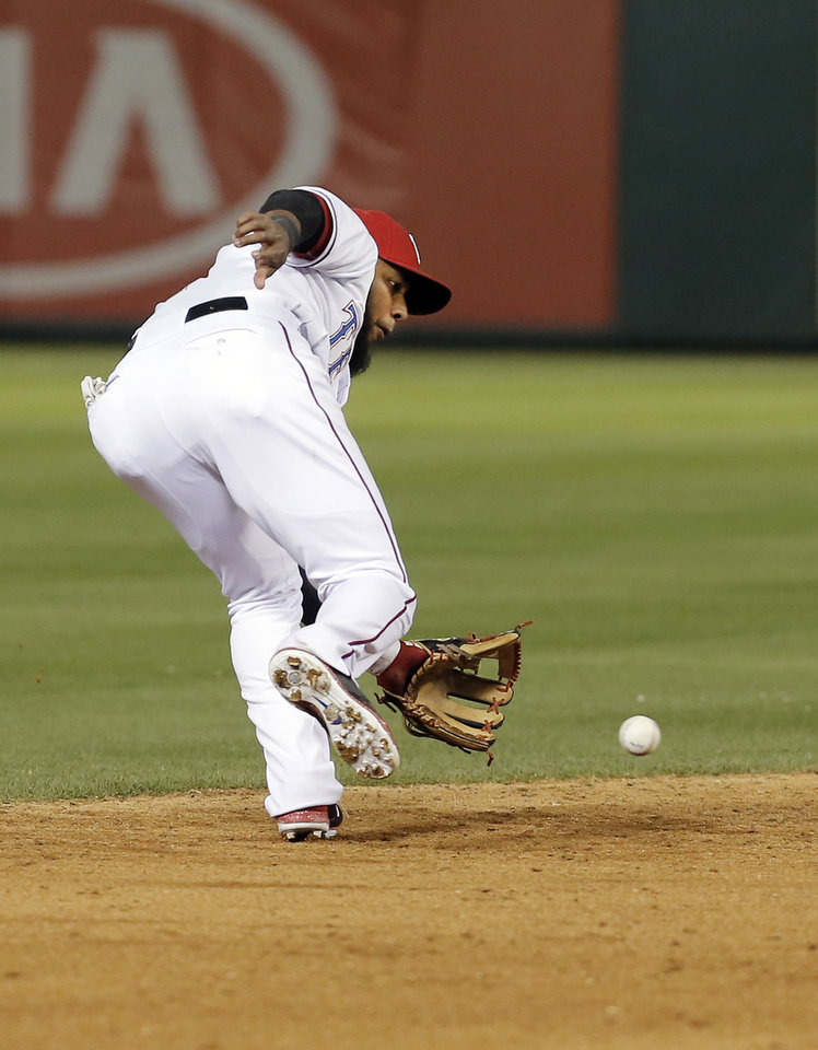 Photo - Texas Rangers shortstop Elvis Andrus (1) fields a hit by Seattle Mariners' Mike Zunino during the ninth inning of a baseball game on Wednesday, April 16, 2014, in Arlington, Texas. Andrus then made the throw to first for the out. Texas won 3-2. (AP Photo/Brandon Wade)