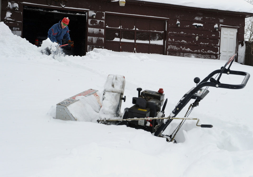 Joe Janeczko helps dig his neighbor out of the snow in East Windsor, Conn. on Saturday, Feb. 9, 2013. A behemoth storm packing hurricane-force wind gusts and blizzard conditions swept through the Northeast overnight. (AP Photo/Jessica Hill) ORG XMIT: CTJH103