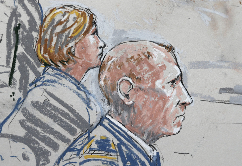 Photo - In this detail from a courtroom sketch, U.S. Army Staff Sgt. Robert Bales, right, sits with one of his civilian attorneys, Emma Scanlan, left, Wednesday, June 5, 2013 , during a plea hearing in a military courtroom at Joint Base Lewis McChord in Washington state. Bales pleaded guilty to multiple counts of murder, stemming from a pre-dawn attack on two villages in Kandahar Province in Afghanistan in March, 2012. (AP Photo/Peter Millett)