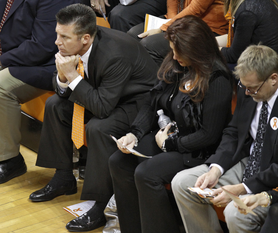 Photo - Oklahoma State football coach Mike Gundy attends the memorial service for Oklahoma State head basketball coach Kurt Budke and assistant coach Miranda Serna at Gallagher-Iba Arena on Monday, Nov. 21, 2011 in Stillwater, Okla. The two were killed in a plane crash along with former state senator Olin Branstetter and his wife Paula while on a recruiting trip in central Arkansas last Thursday. Photo by Chris Landsberger, The Oklahoman