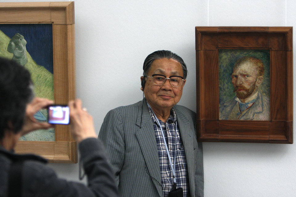 "In this photo taken May 8, 2008, a man poses for a portrait next to the 1887 painting ""self-portrait"" by Vincent van Gogh, at Kroeller-Mueller museum, Otterlo, eastern Netherlands. With the Van Gogh Museum in Amsterdam closed for renovations, the world's second-largest collection of the tortured Dutch master's work is stepping into the limelight. The lesser-known Kroeller-Mueller museum in the eastern Netherlands has revamped the layout of its central rooms, giving more space and focus to many of its top works. (AP Photo/Peter Dejong)"