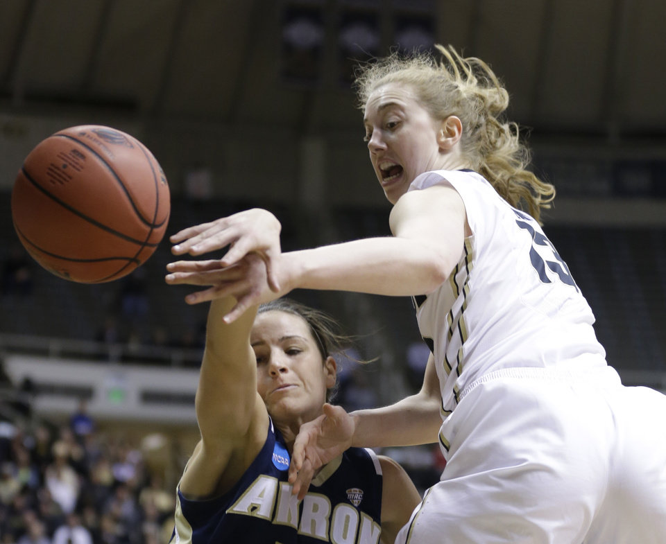 Photo - Purdue guard Bridget Perry, right, and Akron guard Hanna Luburgh fight for a rebound during the second half of a first-round game in the NCAA women's college basketball tournament in West Lafayette, Ind., Saturday, March 22, 2014. Purdue defeated Akron 84-55. (AP Photo/Michael Conroy)