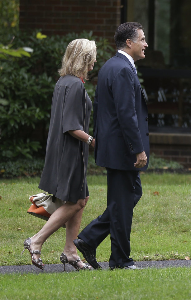 Republican presidential candidate Mitt Romney and wife Ann arrive at The Church of Jesus Christ of Latter-day Saints in Bedford, Mass., Sunday, Sept. 9, 2012. (AP Photo/Charles Dharapak)