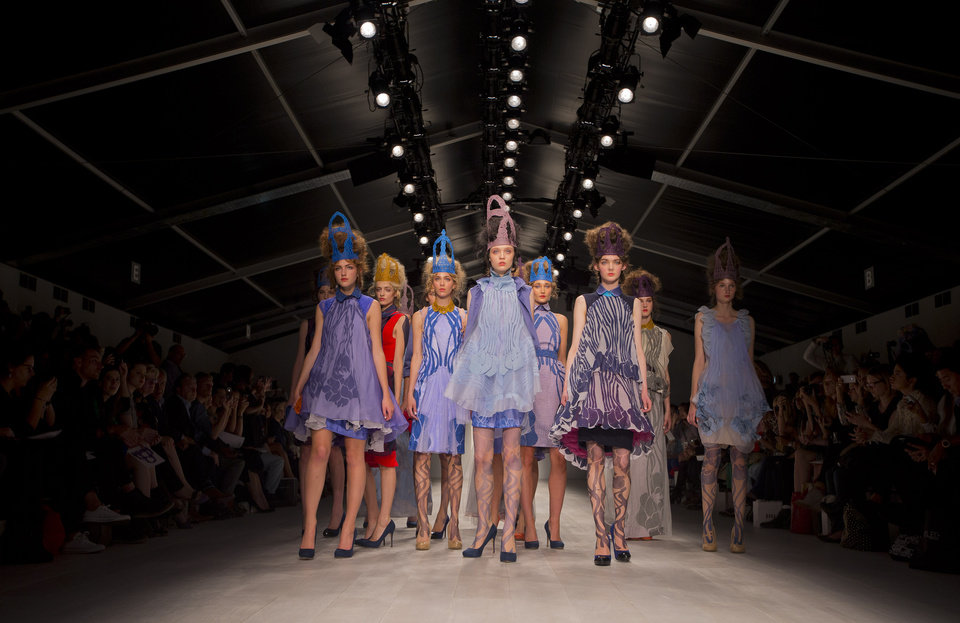 Photo -   Models wear designs from the Bora Aksu Spring/Summer 2013 collection during London Fashion Week, Friday, Sept. 14, 2012. (AP Photo/Joel Ryan)
