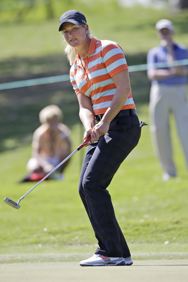 Photo - Suzann Pettersen, of Norway, reacts to missing a putt on the ninth hole during the second round of the North Texas LPGA Shootout golf tournament at the Las Colinas Country Club in Irving, Texas, Friday, May 2, 2014. (AP Photo/LM Otero)