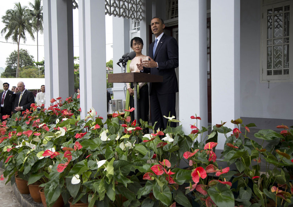 Photo -   U.S. President Barack Obama and Myanmar opposition leader Aung San Suu Kyi speak to press at her residence in Yangon, Myanmar, Monday, Nov. 19, 2012. Obama who touched down Monday morning, becoming the first U.S. president to visit the Asian nation also known as Burma, said his historic visit to Myanmar marks the next step in a new chapter between the two countries. (AP Photo/Carolyn Kaster)