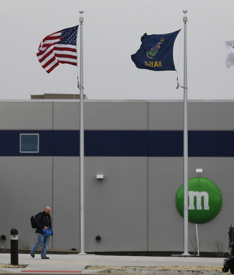 Photo - A man walks out the entrance of the new Mars Inc. production facility near Topeka, Kan., Wednesday, March 26, 2014. It's the company's first new North American production facility in 35 years. (AP Photo/Orlin Wagner)