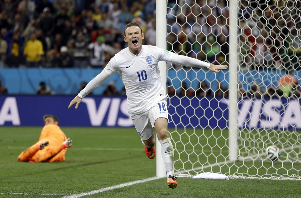 Photo - England's Wayne Rooney celebrates after scoring his side's first goal during the group D World Cup soccer match between Uruguay and England at the Itaquerao Stadium in Sao Paulo, Brazil, Thursday, June 19, 2014.  (AP Photo/Kirsty Wigglesworth)