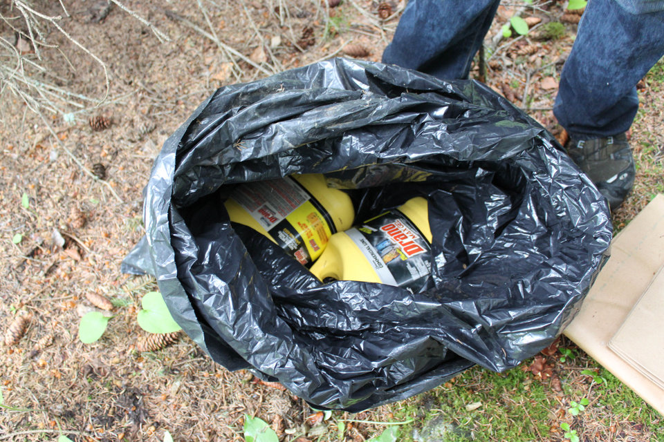 Photo - This undated photo provided by the FBI shows bottles of Drano found inside a plastic bag in Eagle River, Alaska, just north of Anchorage. The FBI says confessed Alaska serial killer Israel Keyes, who targeted people across the country, told authorities he planned to strike again in the state if he had gotten away with the murder of an 18-year-old Anchorage barista. (AP Photo/FBI)