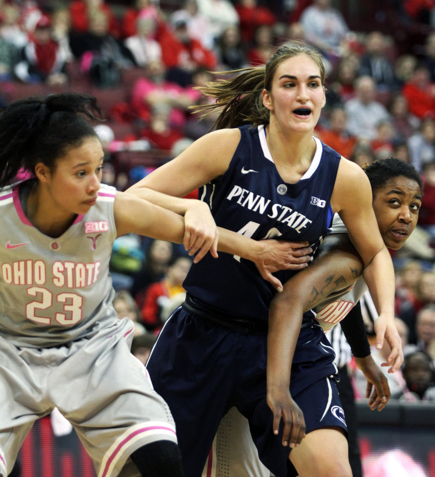 Photo - Ohio State's Martina Ellerbe (23) and Raven Ferguson, right, block out Penn State's Tori Waldner during the first half of an NCAA women's college basketball game, Sunday, Feb. 9, 2014, in Columbus, Ohio. (AP Photo/Mike Munden)