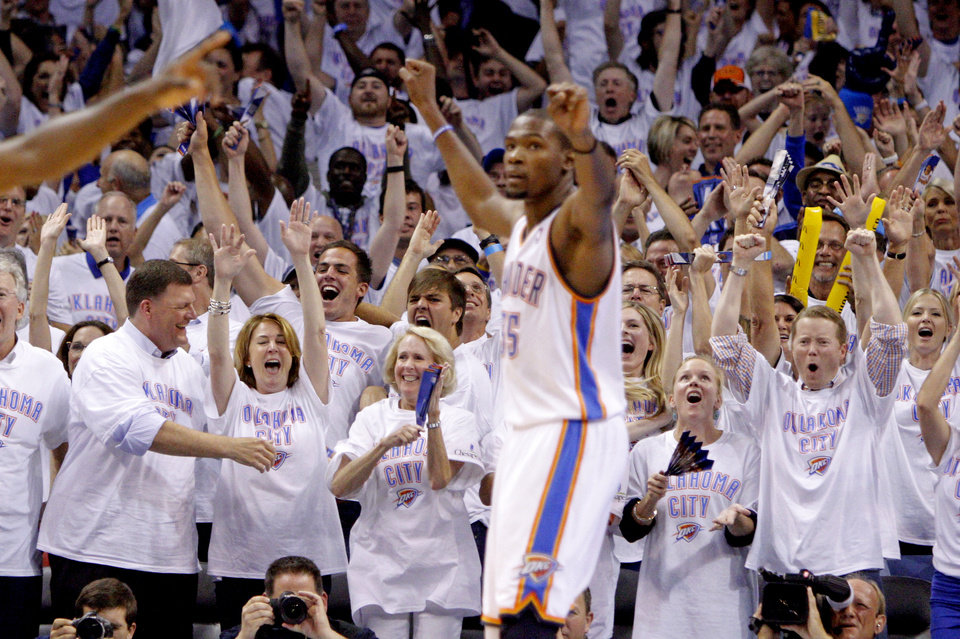 Photo - The crowd reacts behind Oklahoma City's Kevin Durant during Game 6 of the Western Conference Finals between the Oklahoma City Thunder and the San Antonio Spurs in the NBA playoffs at the Chesapeake Energy Arena in Oklahoma City, Wednesday, June 6, 2012. Oklahoma City won 107-99. Photo by Bryan Terry, The Oklahoman