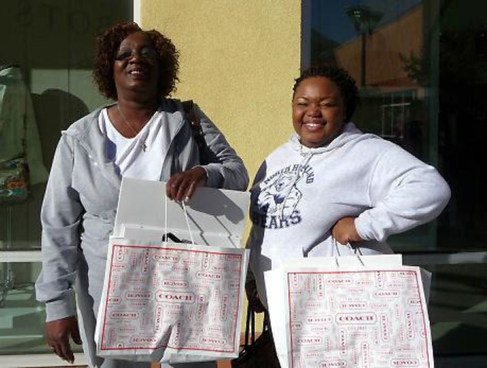 Photo - Tonya Anderson and her daughter, Latoya, said they braved Thursday's long lines at Walmart before ending up at The Outlet Shoppes at Oklahoma City on Friday.