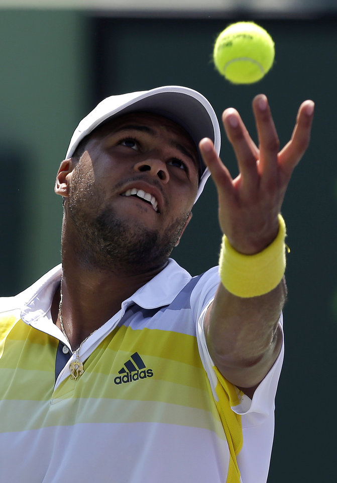 Photo - Jo-Wilfried Tsonga, of France, serves to Viktor Troicki, of Serbia, during the Sony Open tennis tournament, Saturday, March 23, 2013, in Key Biscayne, Fla. (AP Photo/Lynne Sladky)