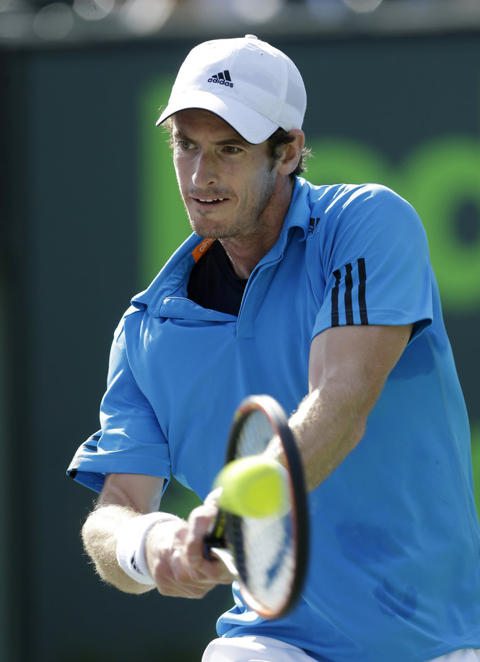 Britain\'s Andy Murray returns to Serbia\'s Novak Djokovic at the Sony Open Tennis tournament in Key Biscayne, Fla., Wednesday, March 26, 2014. (AP Photo/Alan Diaz)