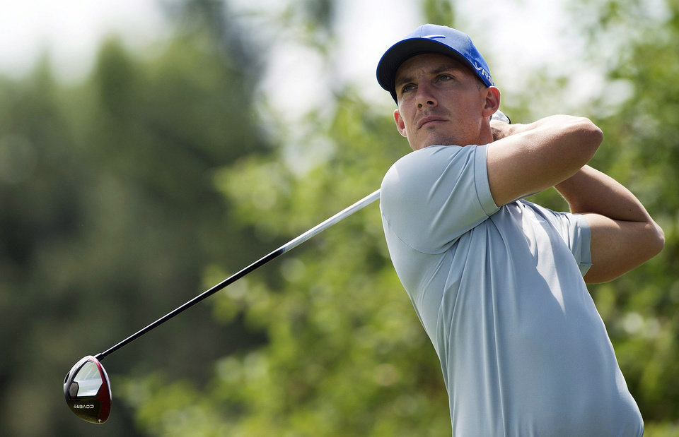 Photo - Jamie Lovemark, from the United States, tees off on the second hole during the third round of the Canadian Open at the Royal Montreal Golf Club in Montreal, Saturday, July 26, 2014. (AP Photo/The Canadian Press, Graham Hughes)