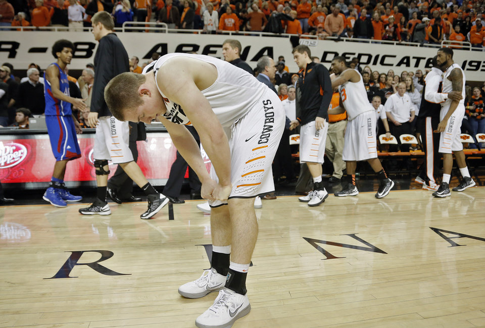 Photo - Oklahoma State 's Phil Forte (13) reacts after the 68-67 double overtime loss to Kansas during the college basketball game between the Oklahoma State University Cowboys (OSU) and the University of Kanas Jayhawks (KU) at Gallagher-Iba Arena on Wednesday, Feb. 20, 2013, in Stillwater, Okla. Photo by Chris Landsberger, The Oklahoman