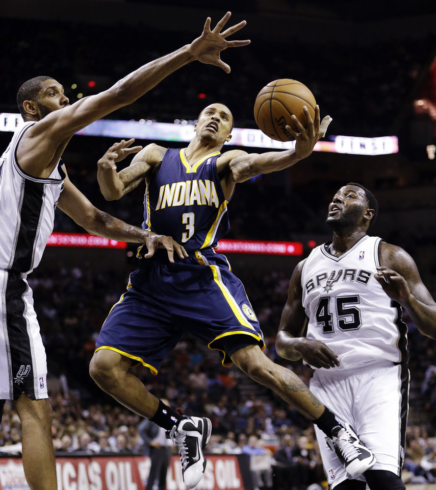 Photo -   Indiana Pacers' George Hill (3) is defended by San Antonio Spurs' Tim Duncan, left, and DeJuan Blair (45) as he drives to the basket during the second quarter of an NBA basketball game, Monday, Nov. 5, 2012, in San Antonio. (AP Photo/Eric Gay)