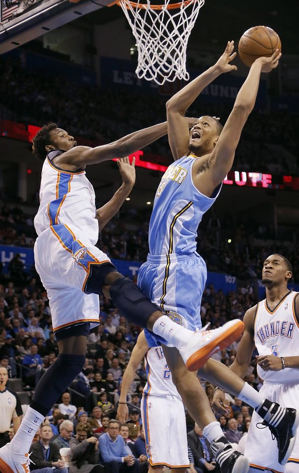 Photo - Oklahoma City's Hasheem Thabeet (34) defends on Denver's Anthony Randolph (15) during the NBA basketball game between the Oklahoma City Thunder and the Denver Nuggets at the Chesapeake Energy Arena on Wednesday, Jan. 16, 2013, in Oklahoma City, Okla.  Photo by Chris Landsberger, The Oklahoman