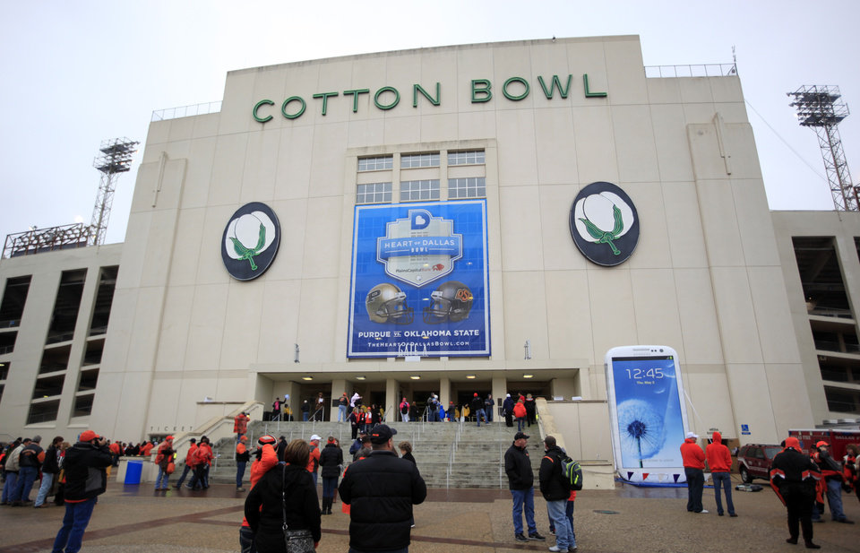 Fans mingle in front of the Cotton Bowl before the Heart of Dallas Bowl football game between the Oklahoma State University (OSU) and Purdue University at the Cotton Bowl in Dallas,  Tuesday, Jan. 1, 2013. Photo by Sarah Phipps, The Oklahoman