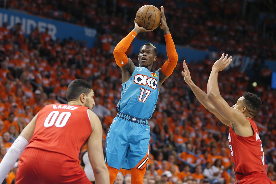 Photo - Oklahoma City's Dennis Schroder (17) shoots a basket beside Portland's CJ McCollum (3) during Game 3 in the first round of the NBA playoffs between the Portland Trail Blazers and the Oklahoma City Thunder at Chesapeake Energy Arena in Oklahoma City, Friday, April 19, 2019. Oklahoma City won 120-108. Photo by Bryan Terry, The Oklahoman