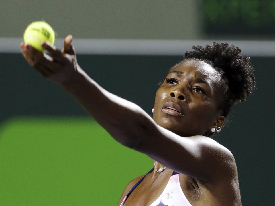 Photo - Venus Williams serves to Kimiko Date-Krumm, of Japan, during the Sony Open tennis tournament, Thursday, March 21, 2013, in Key Biscayne, Fla. (AP Photo/Wilfredo Lee)