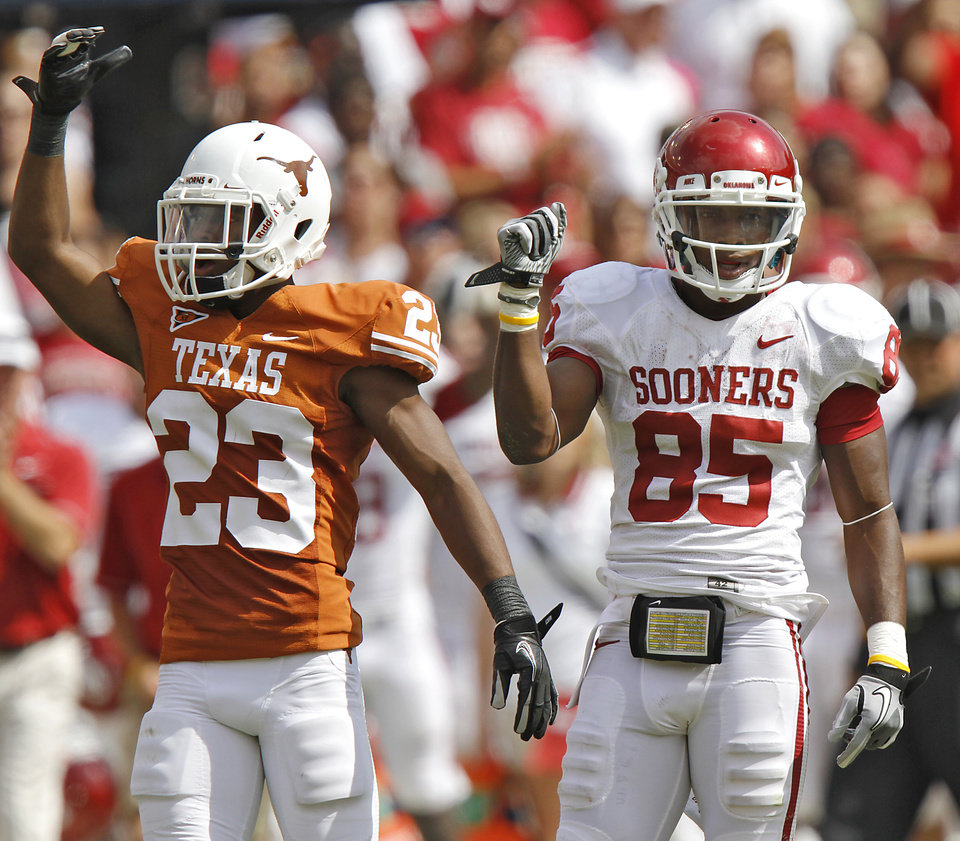 Oklahoma's Ryan Broyles (85) reacts as Texas' Carrington Byndom (23) is flagged for pass interference during the Red River Rivalry college football game between the University of Oklahoma Sooners (OU) and the University of Texas Longhorns (UT) at the Cotton Bowl in Dallas, Saturday, Oct. 8, 2011. Photo by Chris Landsberger, The Oklahoman