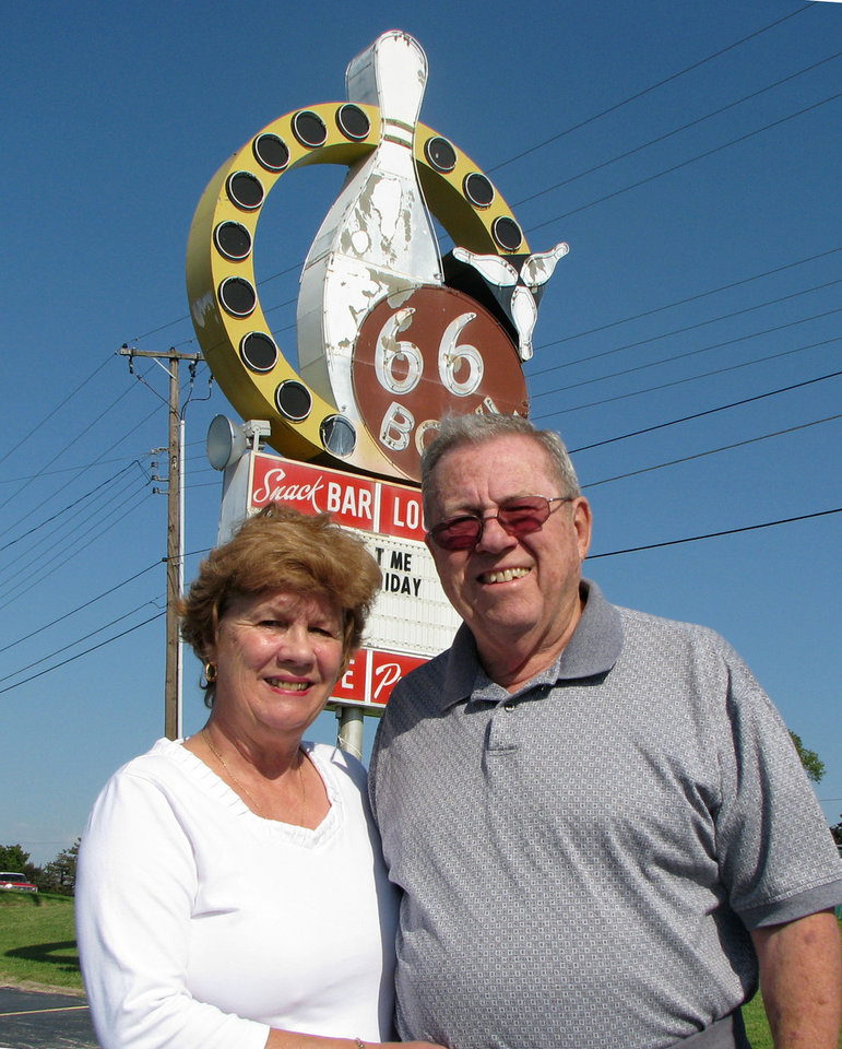 Photo - BOWLING ALLEY / 50 / 50TH ANNIVERSARY / PEGGY HAYNES: Jim Haynes, owners of the 66 Bowl, and his wife Peggy stand in front of the sign for their business, at 3810 NW Expressway in Oklahoma City, OK,  which is celebrating it's 50th anniversary, August 26, 2009.   BY ROBERT MEDLEY/THE OKLAHOMAN