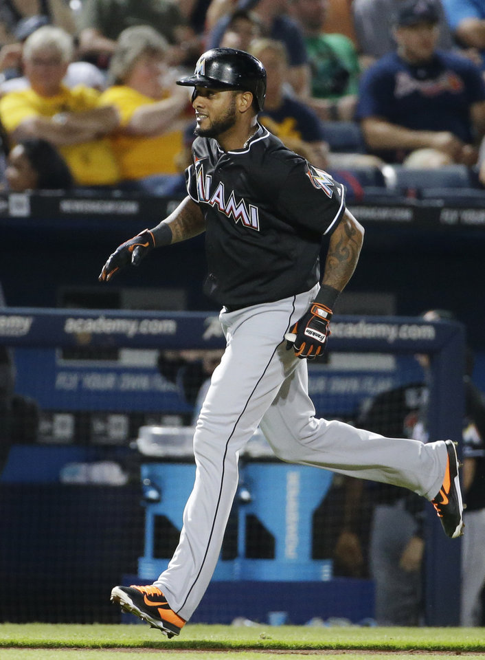 Photo - Miami Marlins' Jordany Valdespin rounds third base after hitting a home run in the seventh inning of a baseball game against the Atlanta Braves, Friday, Aug. 29, 2014, in Atlanta. (AP Photo/David Goldman)