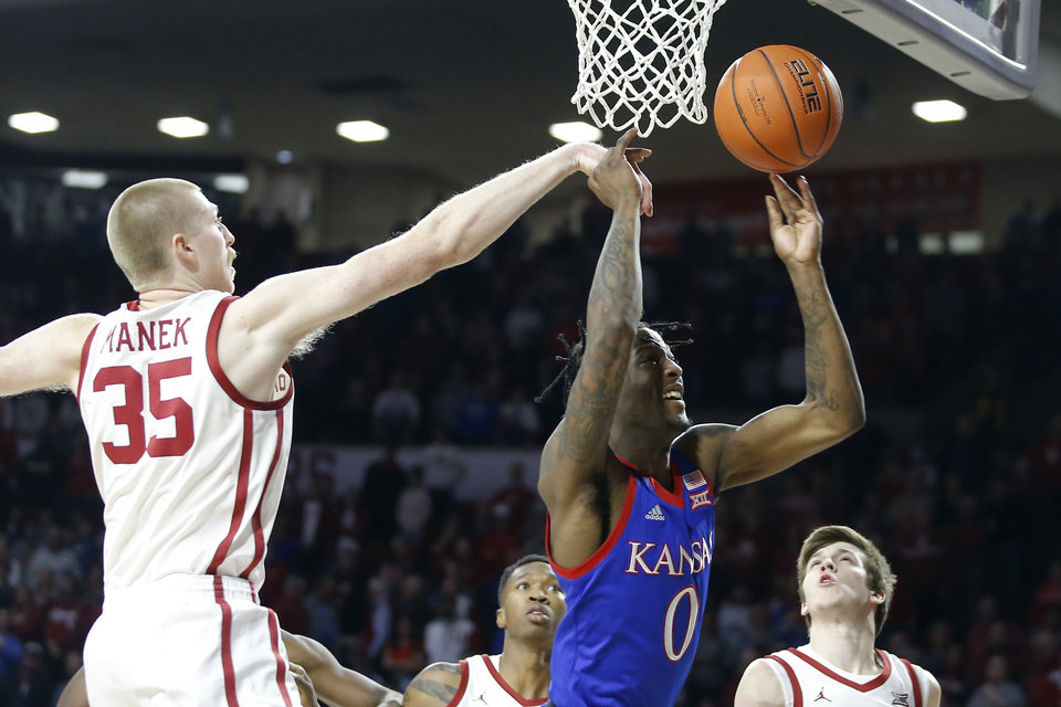 Photo - Oklahoma's Brady Manek (35) block the shot of Kansas' Marcus Garrett (0) during an NCAA college basketball game between the University of Oklahoma Sooners (OU) and the University of Kansas Jayhawks at Lloyd Noble Center in Norman, Okla., Tuesday, Jan. 14, 2020. [Bryan Terry/The Oklahoman]