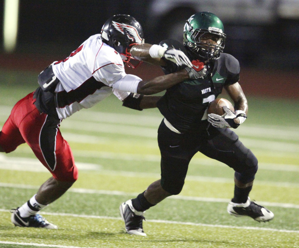 Photo - Del City's (7)  Jerell Jeter  tries to catch Emilio Gatewood (2) as the Eagles play Norman North in high school football at Harve Collins Field on Thursday, Sept. 9, 2010, in Norman, Okla.  Photo by Steve Sisney, The Oklahoman