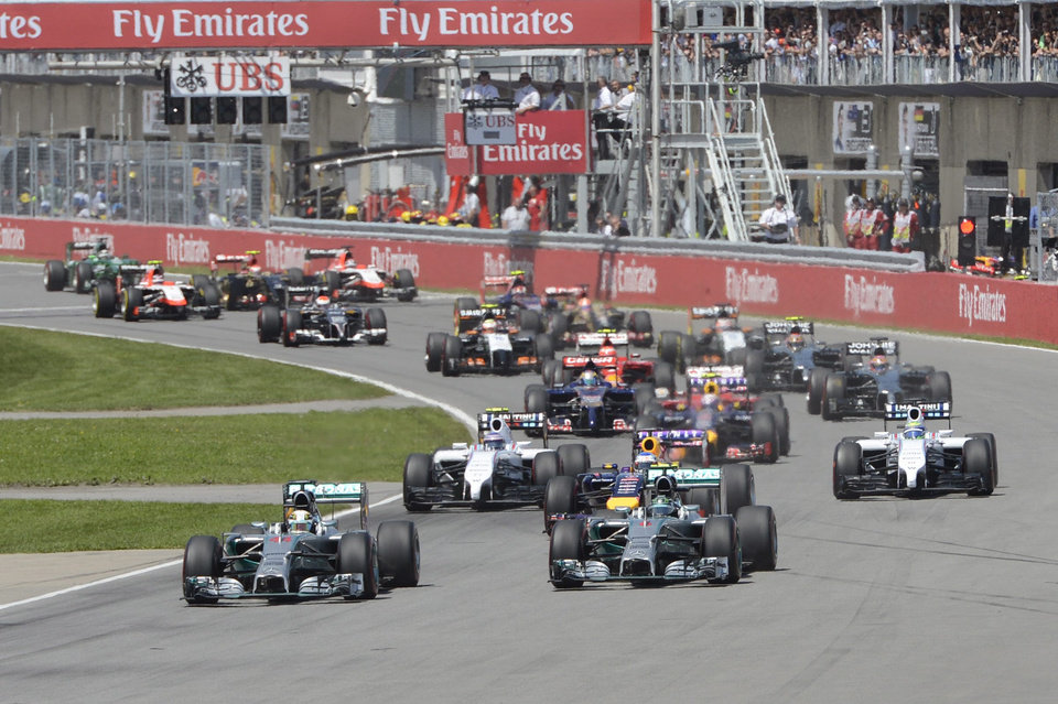 Photo - Mercedes driver Nico Rosberg, right,  from Germany, and teammate Lewis Hamilton of Great Britain vie for position at the start of the Canadian Grand Prix, Sunday, June 8, 2014 in Montreal. (AP Photo/The Canadian Press, Ryan Remiorz)