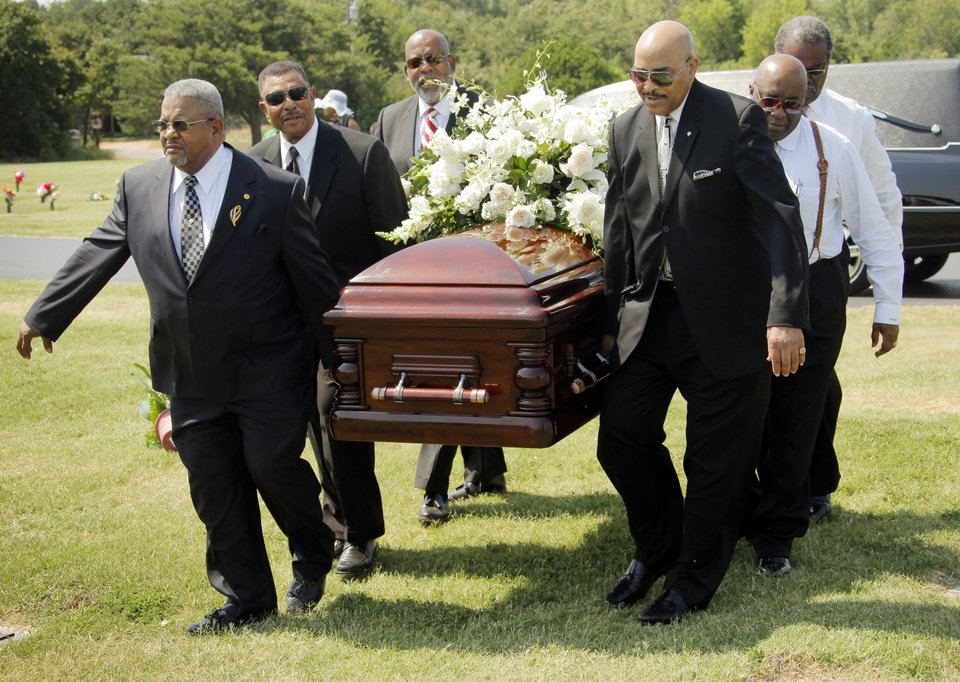 Photo - Pallbearers carry the casket of Clara Luper during the graveside memorial service for civil rights activist Clara Luper at the Hillcrest Memorial Gardens cemetery in Spencer, Okla., Friday, June 17, 2011.  Luper was 88 years old when she died on June 8, 2011. Photo by Nate Billings, The Oklahoman