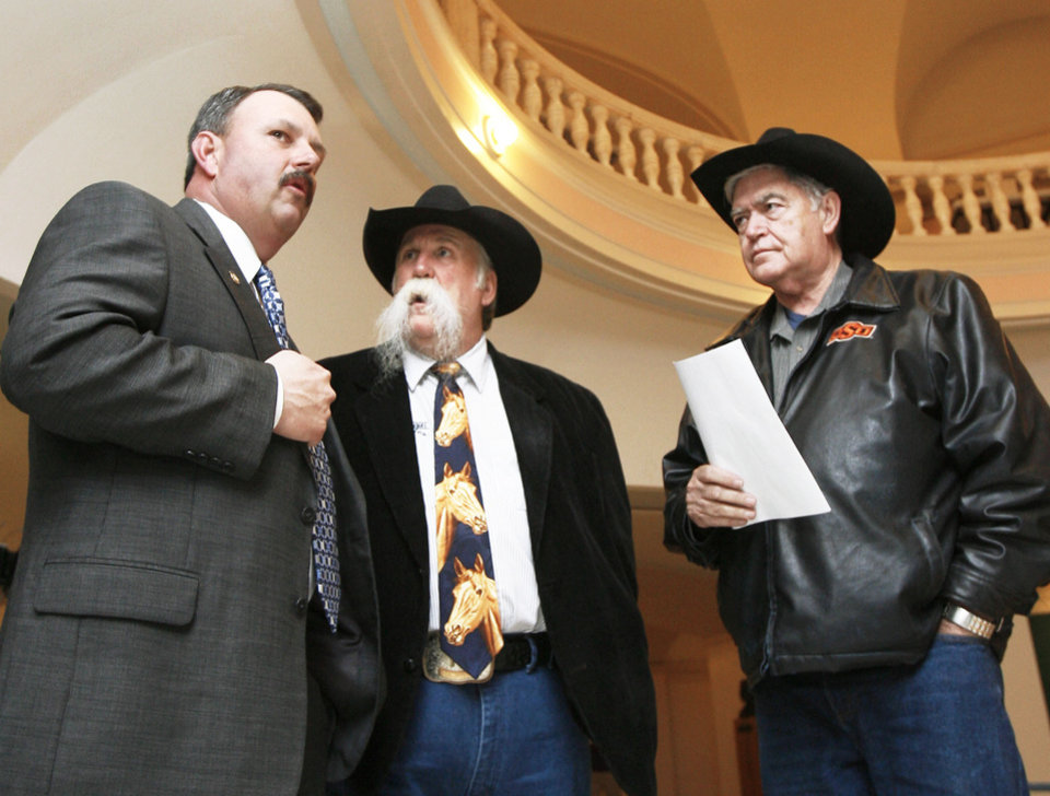 Photo - State Rep. Don Armes, R-Faxon, talks Tuesday with horse owners Doug Sauter, who also is coach of the Oklahoma City Blazers, and Don Rogers.  PHOTO BY PAUL HELLSTERN, THE OKLAHOMAN