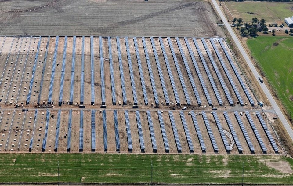 Photo -  This aerial photograph, which shows Oklahoma Gas and Electric's Covington solar generating facility while it was still being built, illustrates how the panels will rotate to track the sun.
