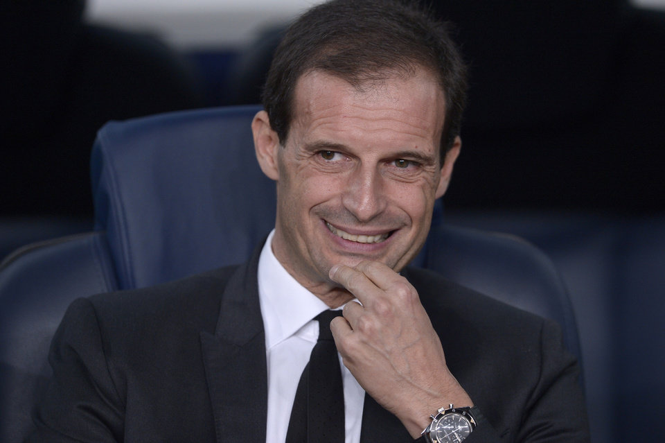 Photo - FILE - In this file photo taken in Barcelona on Nov. 6, 2013, AC Milan former coach Massimiliano Allegri waits for the start of the Champions League match between FC Barcelona and AC Milan. Massimiliano Allegri has been hired to coach Italian champion Juventus a day after Antonio Conte unexpectedly left the club. The 46-year-old Allegri was fired by Milan in January after 3 1/2 seasons with the squad, having led the Rossoneri to the Serie A title in his first year in charge in 2010-11.The 46-year-old Allegri was fired by Milan in January after 3 1/2 seasons with the squad, having led the Rossoneri to the Serie A title in his first year in charge in 2010-11. (AP Photo/Manu Fernandez)